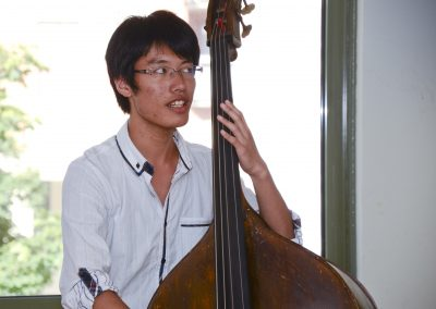 Swedish folk music class, a student playing the double bass