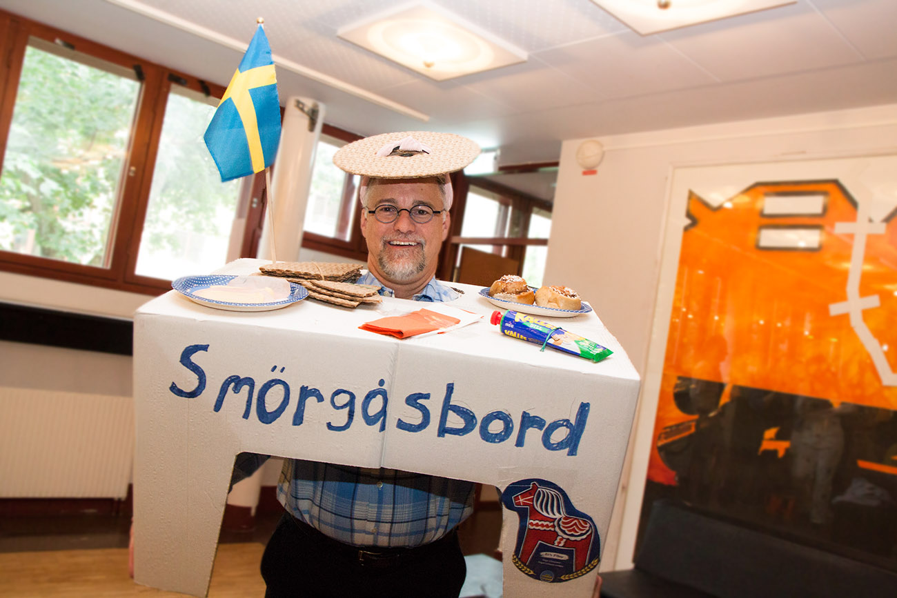 """Student dressed up as a traditional Swedish """"smörgåsbord"""" for the Farewell Dinner themed """"Typically Swedish"""""""